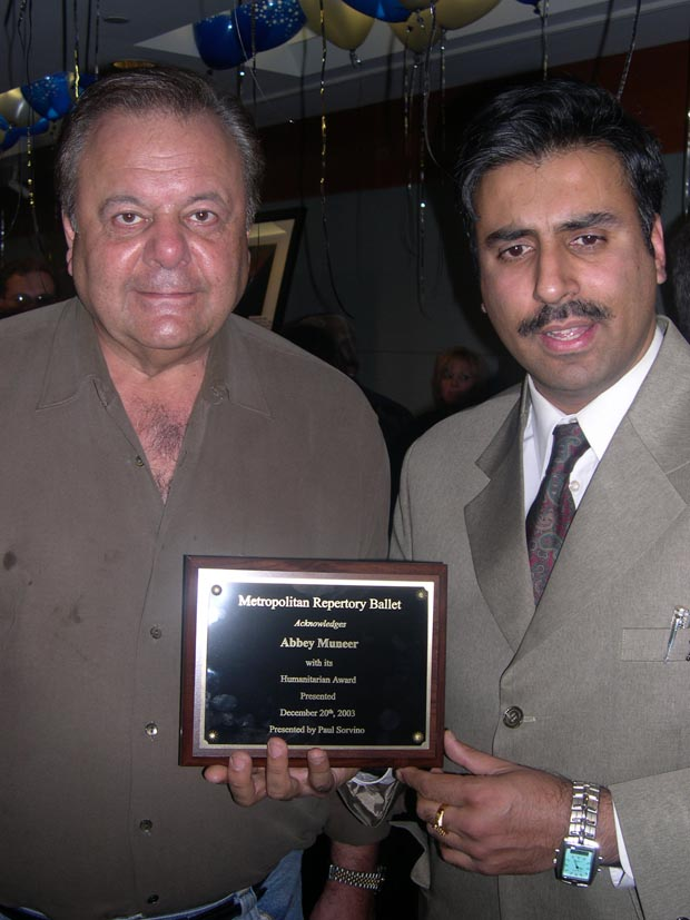 Dr. Abbey recieving Award from Paul Sorvino at  Lincoln Center 12 22 03
