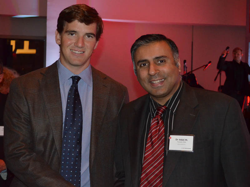 Dr.Abbey with Giants Quaterback Eli Manning