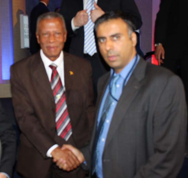 Dr.Abbey with Prime Minister Tillman Thomas of Grenada