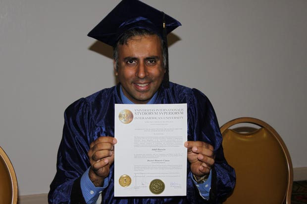 Dr.Abbey Holding his PHD Degree