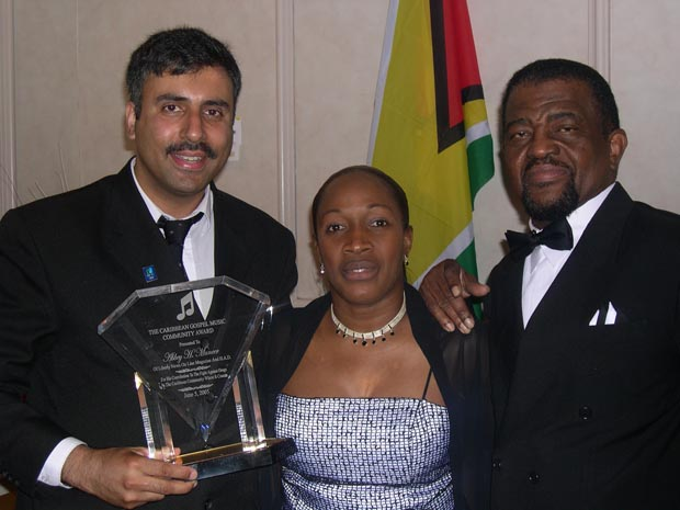 Dr.Abbey being Presented  an Award by Hopeton lewis